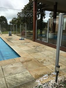 After cleaning glass pool fence Geelong