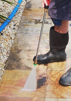 Pressure washing a sandstone paver Curlewis